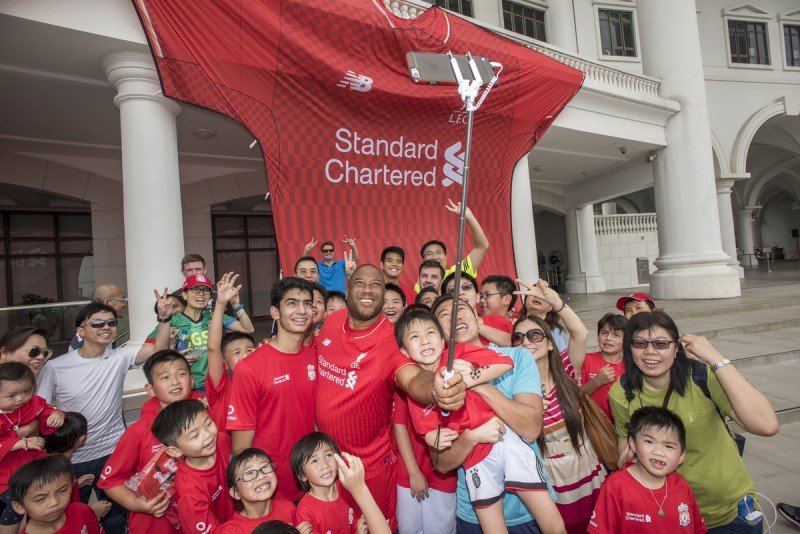 Former Liverpool Football Club star John Barnes participates in the Standard Chartered Liverpool Football Clinic at the Harrow International School in Hong Kong, China, on Sunday, April 17, 2016. Photographer: David Paul Morris/i3